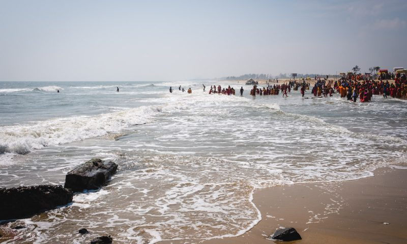 Hindu Pilgrims bathing in the sea at Mahabalipuram