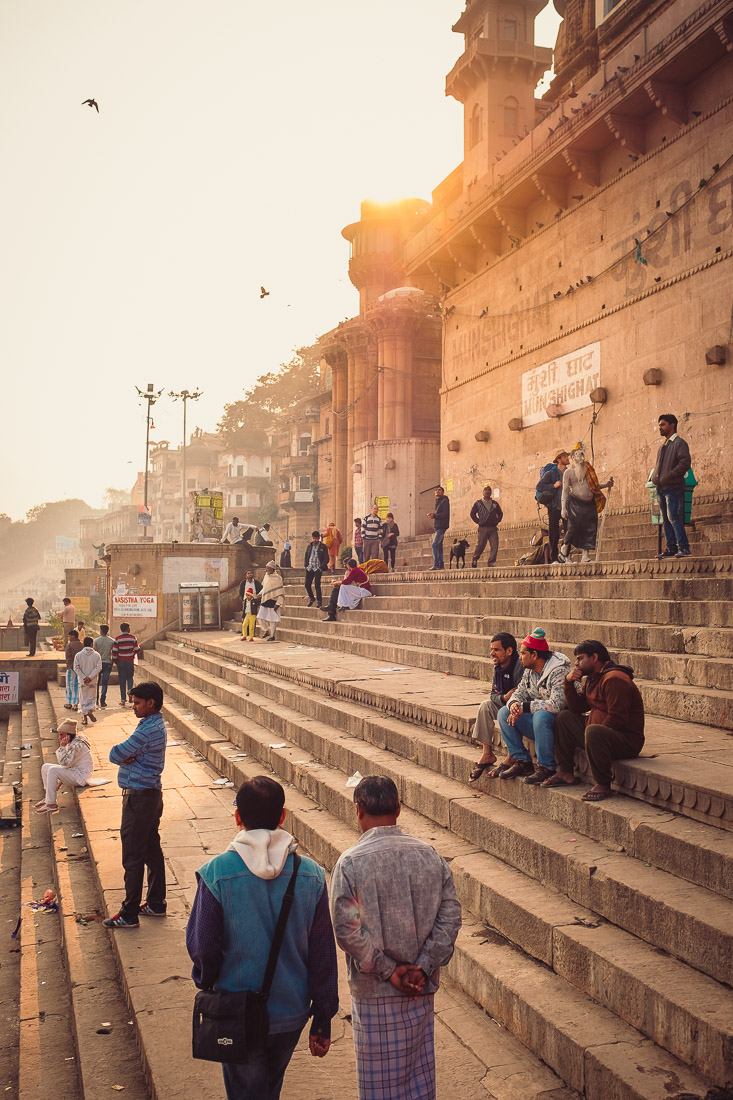 People relaxing on the stone Ghats in Varanasi, India, in the evening