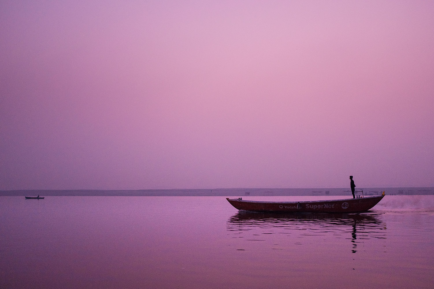 Boatman on the river Ganges in India